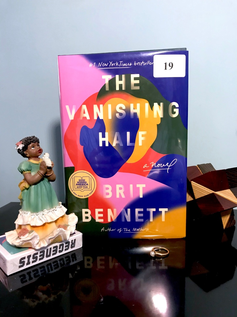 Book cover for The Vanishing Half by Brit Bennett with Black angel and black and white cube.